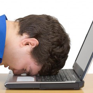 image of discouraged writer writing his college application essay